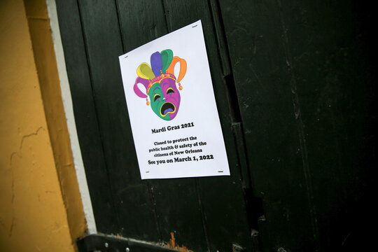 A sign posted on the door of a closed Bourbon St. bar is pictured amid stepped-up coronavirus disease (COVID-19) protocols on Fat Tuesday in New Orleans