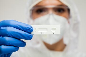 Healthcare UK NHS frontliner holding Coronavirus COVID-19 rapid diagnostic test ki