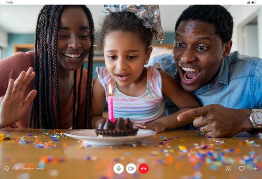 Family celebrating birthday at home.