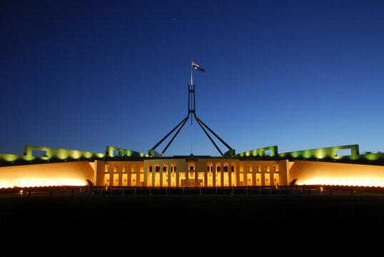 The Parliament House illuminated at dusk in the Australian Capital Territory, Canberra, Australia