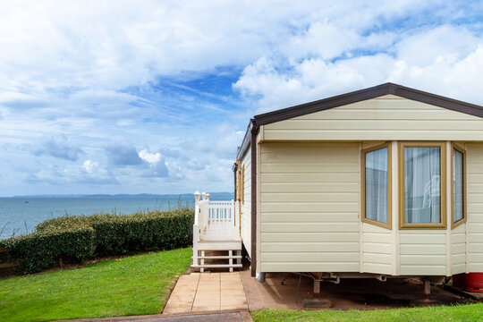 Caravan holiday park with white mobile houses, typical resort of English seaside.