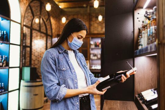 Shopper in liquor store during covid-19 outbreak