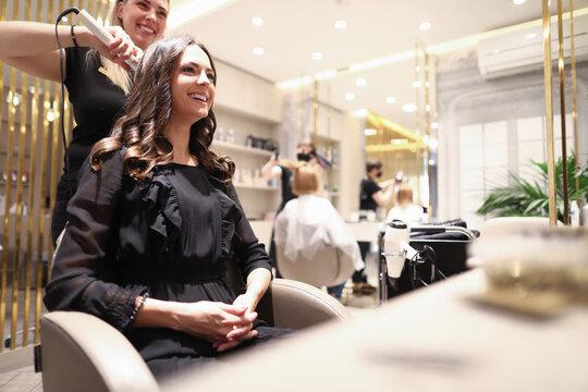 Hair stylist doing hairdo