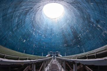 Fototapeta Blue cooling tower in abandoned power plant EC2