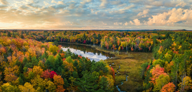 Colorful autumn sunset over Snipe Lake in the Hiawatha National Forest – Michigan Upper Peninsula – aerial view