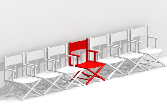 Row of chairs with one red