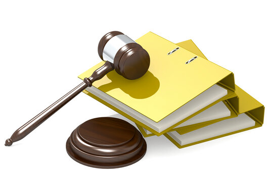 Wooden judge gavel and yellow folder