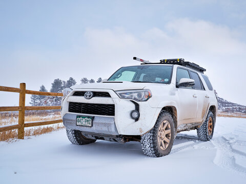 Toyota 4Runner SUV (2016 Trail edition) visiting Lory State Park at foothills of Rocky Mountains with a fresh snow.