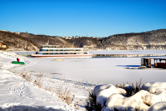 Beautiful snowy landscape with excurision ship at the Edersee in winter.