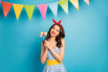 Portrait of her she nice attractive lovely pretty glamorous cheerful cheery girl holding in hands handmade decor eggs on sticks isolated on bright vivid shine vibrant blue color background