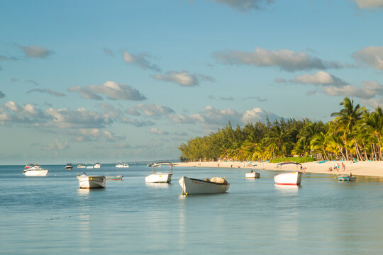 Boats lying in the lagoon at the beach in Le Morne in Mauritius, Africa.