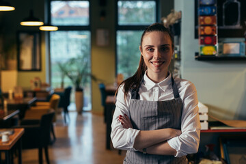 waitress standing crossed arms in cafe - fototapety na wymiar