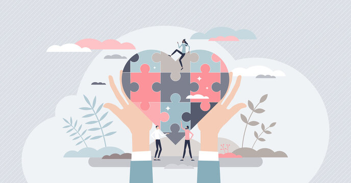 Social care with jigsaw pieces heart as charity and help tiny person concept