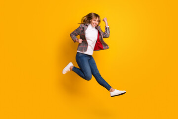 Wall Mural - Full length portrait of astonished cheerful person fists up celebrate isolated on yellow color background