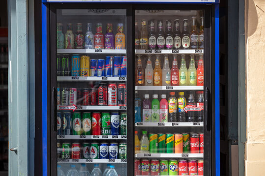 Refreshments, outdoors refrigerator background. Soft drinks street trade