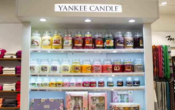 Moscow, Russia, November 2020: Corner of the Yankee candle brand in the megamall. Showcase with a variety of scented candles in glass jars