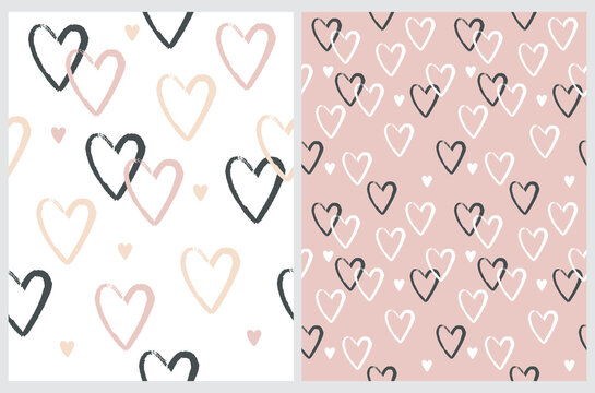 Cute Hand Drawn Irregular Hearts Vector Patterns. White, Black and Pink Hearts on a Light Pink and White Background. Funny Romantic Infantile Style Print. Love Symbol.