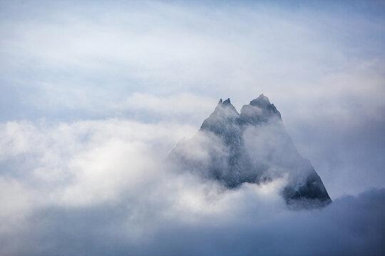 Khumbu Yul Lha mountain shrouded in clouds. Himalayas, Nepal