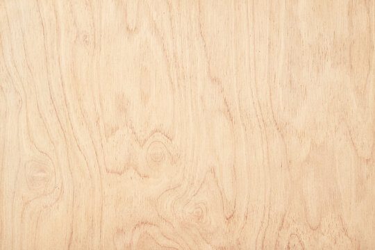 abstract wood texture, light table surface as background. wood panel with natural pattern
