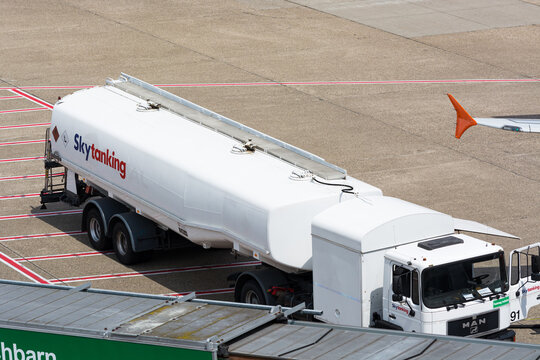 DUESSELDORF, NRW, GERMANY - JUNE 18, 2019: Tank truck of aviation fuel services on an airport runway