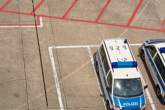 DUESSELDORF, NRW, GERMANY - JUNE 18, 2019: Top view of vehicles VW-Buse of the Federal Police at the airport