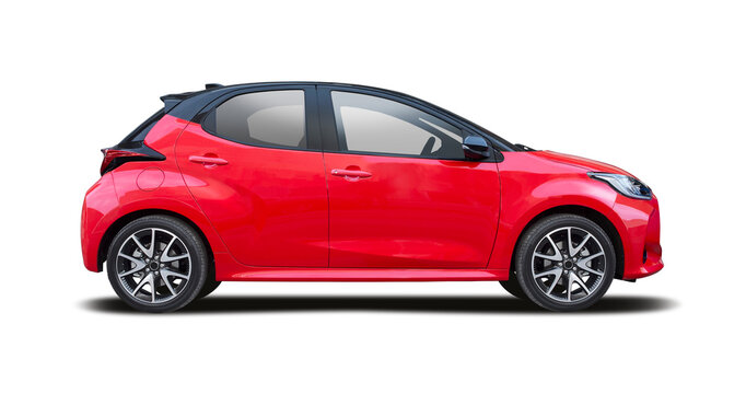 Red hatchback car side view isolated on white background