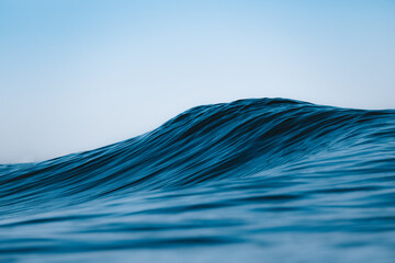Close-up of a blue wave on a summer day
