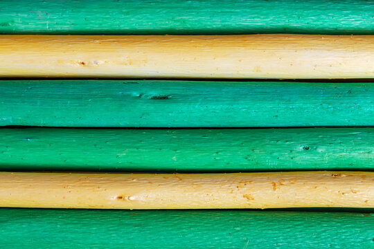Bright colored Wooden rounded plank texture in green yellow colors, cracks, scratches, modern design, background