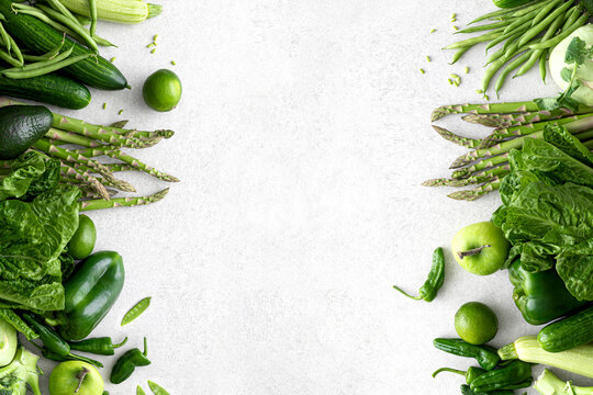 Green vegetables. Fresh green produce. Natural plant based eating. Healthy vegetarian food concept background. Flat lay. Top down view