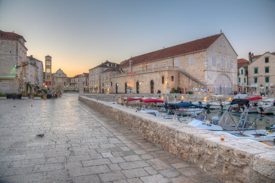 Arsenal in Hvar with cathedral of Saint Stephan in background, Croatia