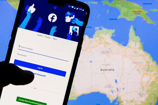 Smartphone with Facebook's login screen against the map of Australia in the background. Facebook recently blocked users in Australia from sharing News articles on the platform.