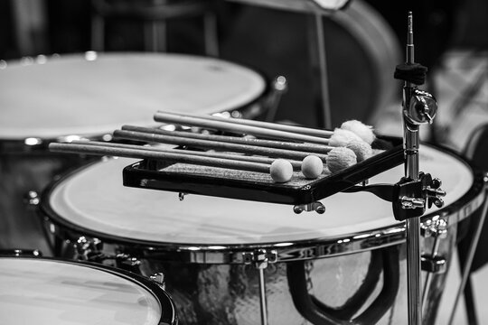 Drum sticks on a stand in black and white