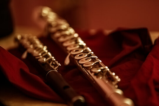 Fragment of a flute close-up in golden tones
