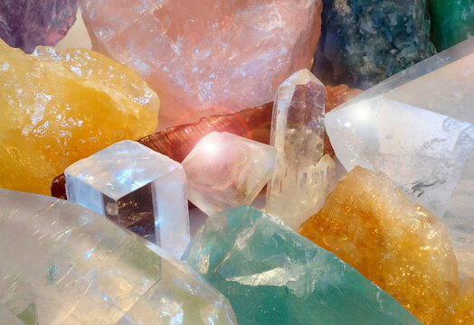 Sparkling Cave of crystals of colorful minerals and gems. Symbol for treasure hunt and rough mineral specimens.