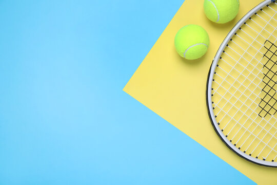 Tennis racket and balls on color background, flat lay. Space for text
