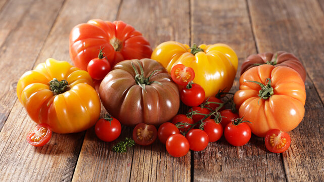 assorted of tomatoes on wood background