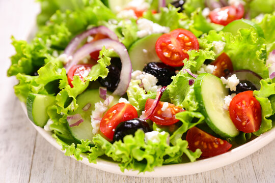 vegetable salad with tomato, cucumber and olive