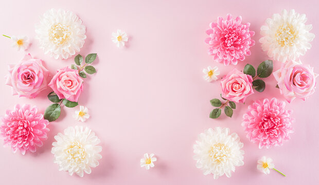 Happy women's day concept, pink roses with beautiful flower frame on pastel background. Flat lay ,top view with space.