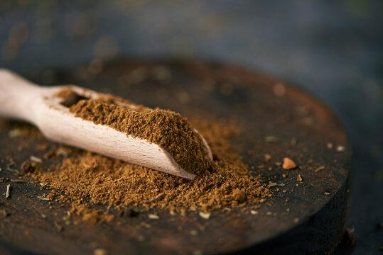 garam masala in a wooden measuring scoop