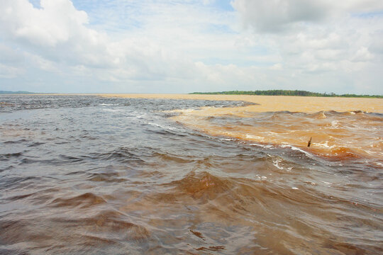Meeting of the Waters of Rio Negro and the Amazon River or Rio Solimoes near Manaus, Amazonas, Brazil in South America.