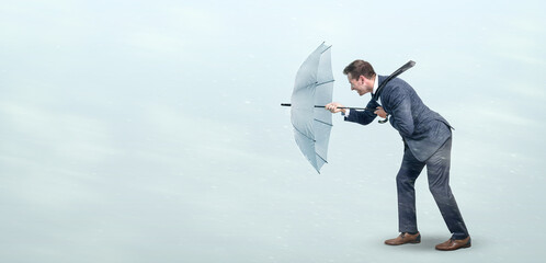 Fototapeta Businessman defying strong headwind obraz