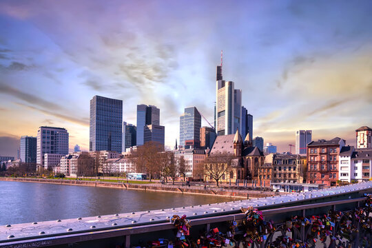 Picturesque view of Frankfurt am Main skyline and Eiserner Steg bridge with love locks
