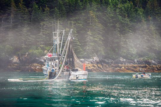 Ocean fishing boat set up the net for salmon in Alaska bay