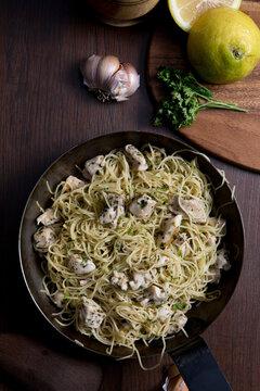 Angel hair pasta dish with chicken lemon parsley