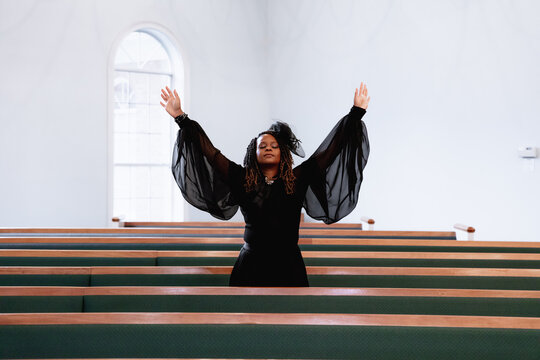 Black woman giving praise and worship to heavenly Father on Easter Sunday