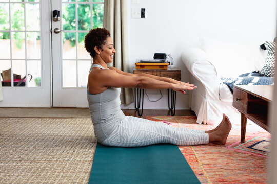 African American woman doing palates core strength training at home
