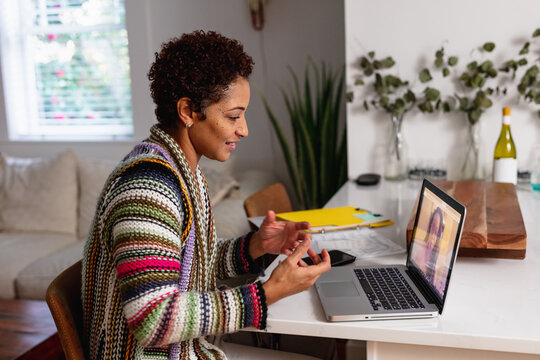 Black woman video chat with client remotely, consultant