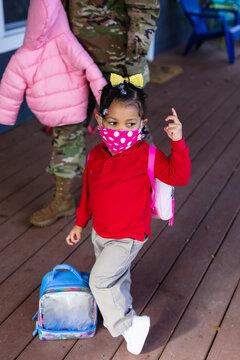Toddler wearing facemask going to school
