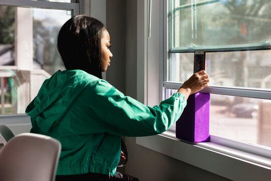 Black teen girl doing live video social media chat