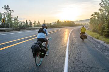 Cyclists on road, Ontario, Canada Fotobehang